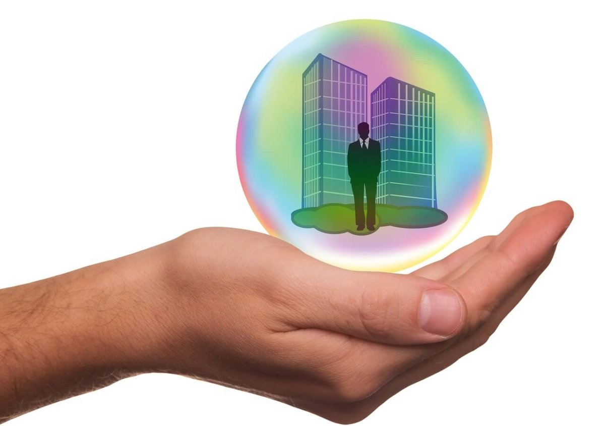 hand holding business in protective bubble