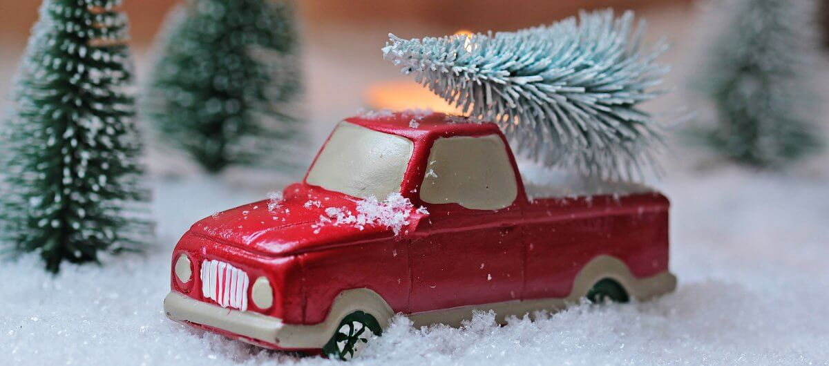 toy truck carrying christmas tree