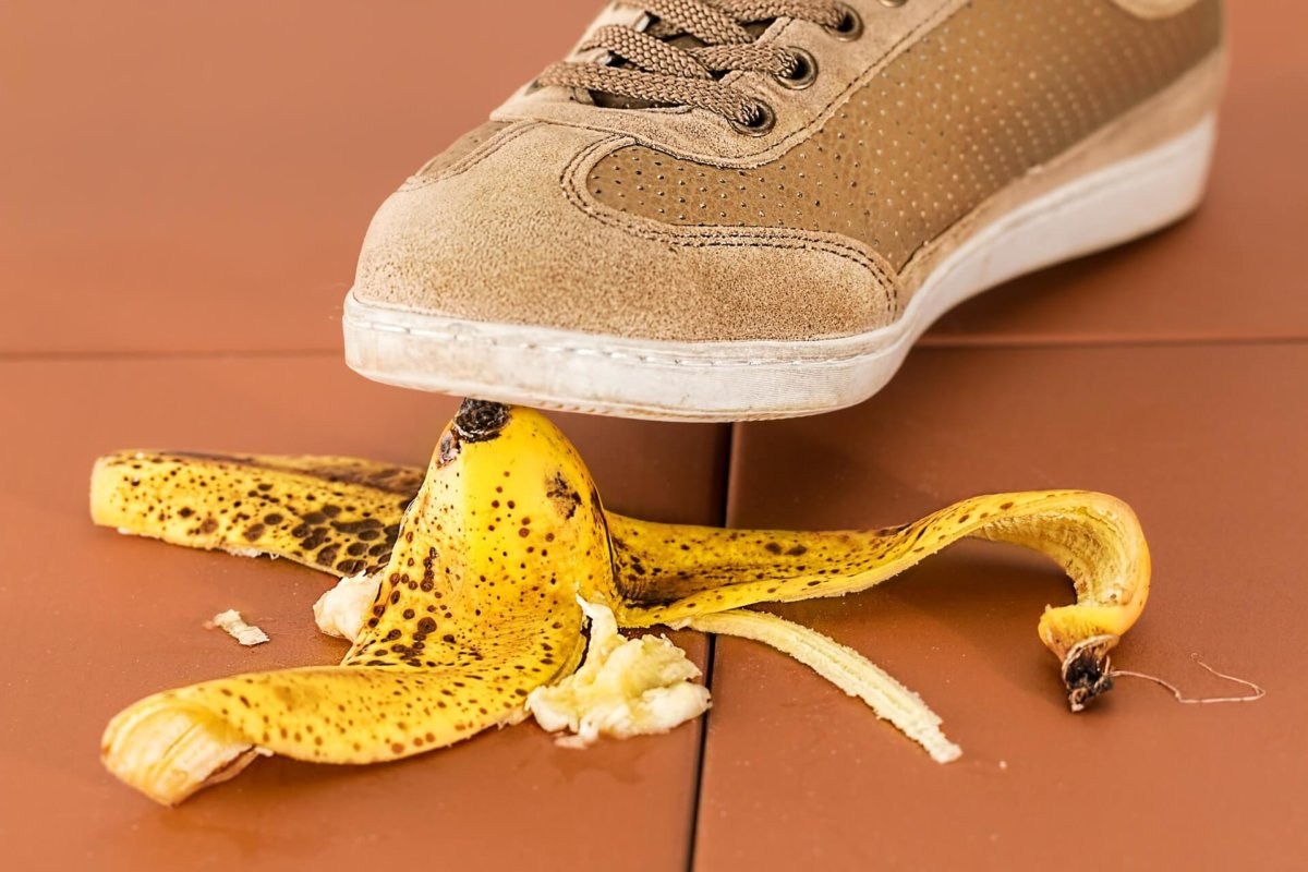shoe stepping on banana peel